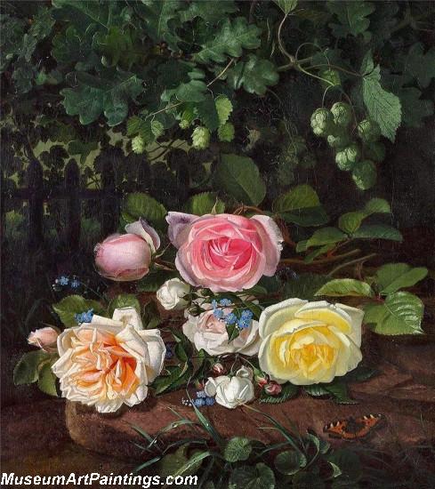 Brogede roser og humlegrene ved et stakit